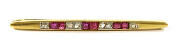 An Art Deco, gold, ruby and diamond bar brooch,