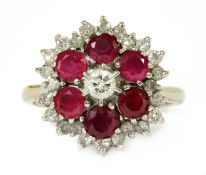 A white gold diamond and ruby target cluster ring,