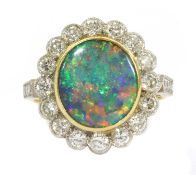 A gold boulder opal and diamond cluster ring,