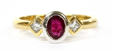 An 18ct gold ruby and diamond three stone ring,