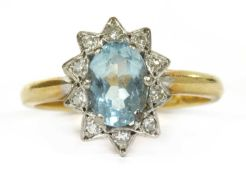 A gold aquamarine and diamond cluster ring,