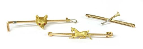 A group of gold equestrian brooches,
