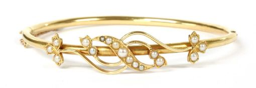 A Victorian gold split pearl hinged bangle,
