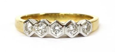 An 18ct gold five stone diamond ring,