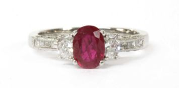 An 18ct white gold ruby and diamond three stone ring,