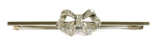 A white gold diamond set bow brooch, c.1925,