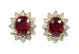 A pair of gold ruby and diamond cluster earrings,