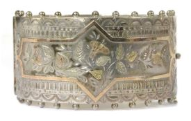 A late Victorian sterling silver hinged bangle,