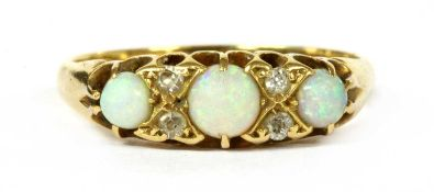 An Edwardian 18ct gold opal and diamond seven stone ring,
