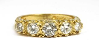 An 18ct gold carved head-style five stone diamond ring,