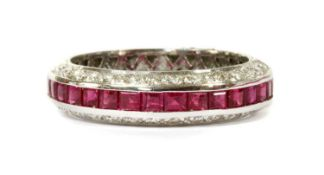 A white gold ruby and diamond half eternity ring,
