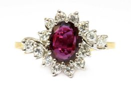 An 18ct gold ruby and diamond crossover cluster ring,