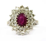 A white gold ruby and diamond cluster ring,