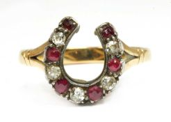 A gold and silver, diamond and ruby, horseshoe ring,