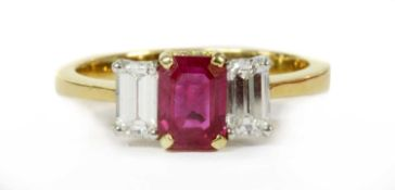 A gold ruby and diamond three stone ring,