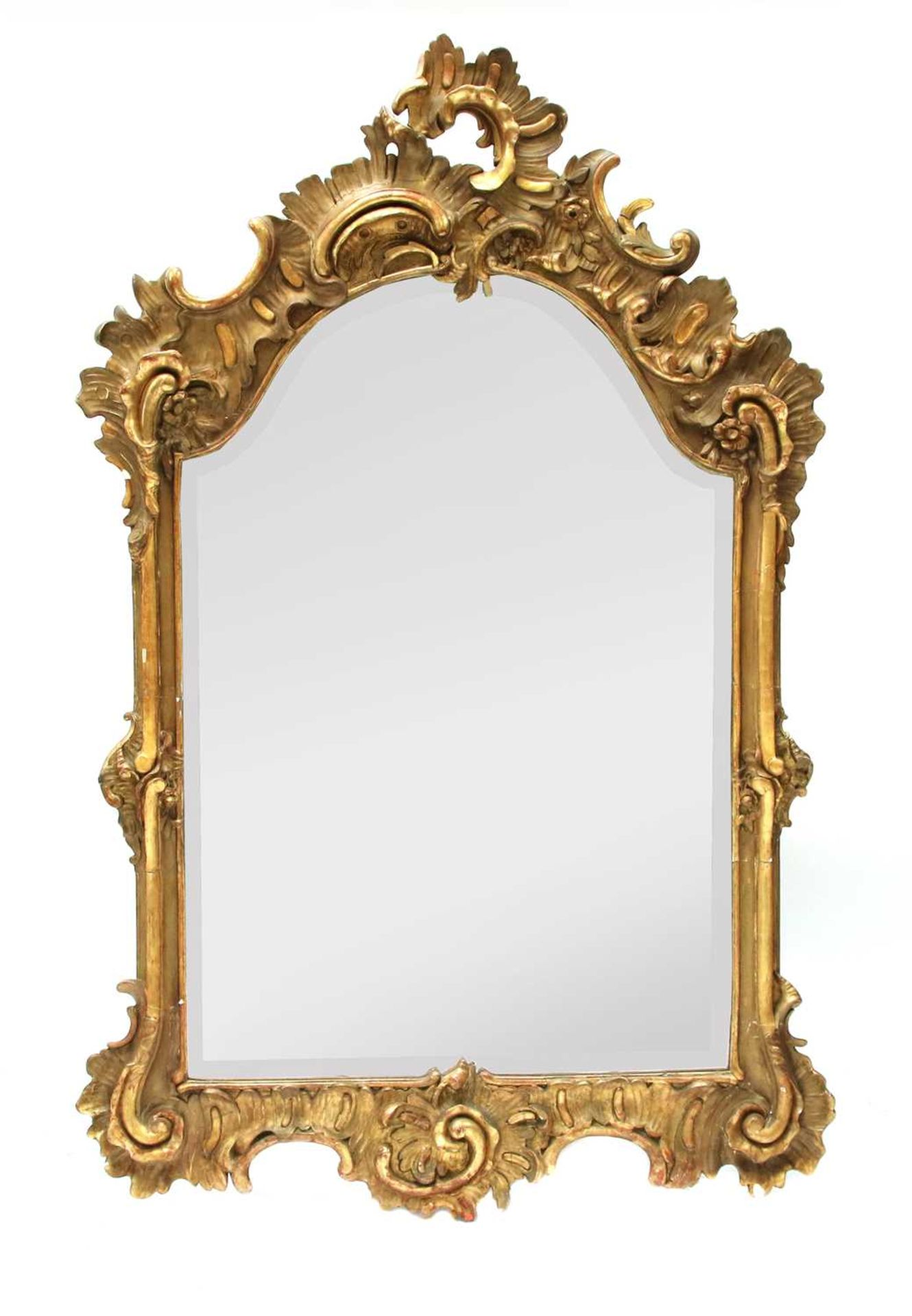 A north European giltwood and gilt composition wall mirror,