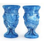 A pair of glass 'gryphon' urns