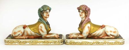 A pair of pottery sphinxes,