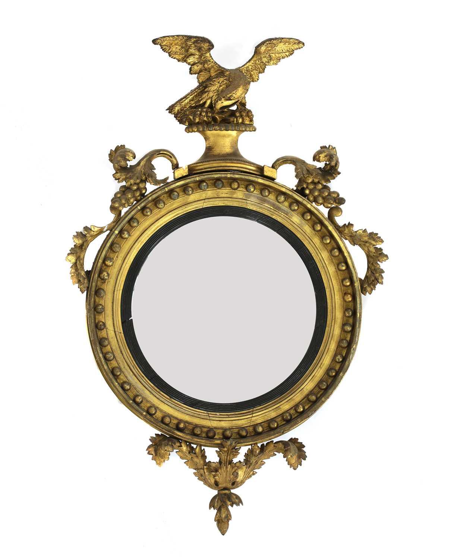A Regency giltwood convex mirror,