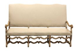 A French bleached oak three-seater sofa,