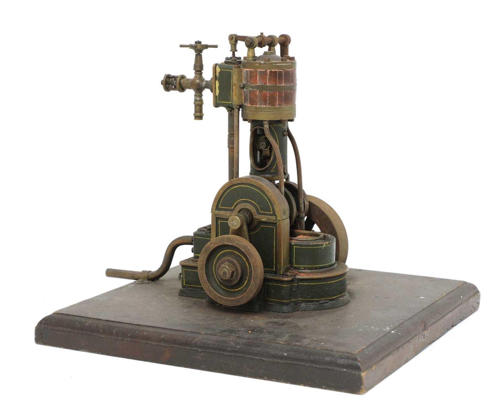 A vertical cylinder live steam engine,