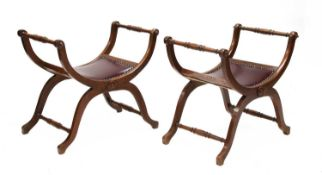A pair of French beech X-framed stools,