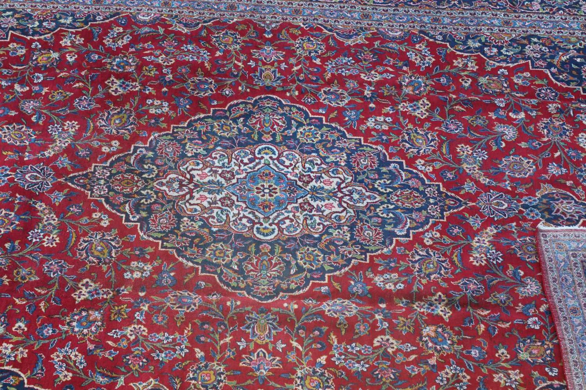 A large Persian Kashan carpet, - Image 2 of 3