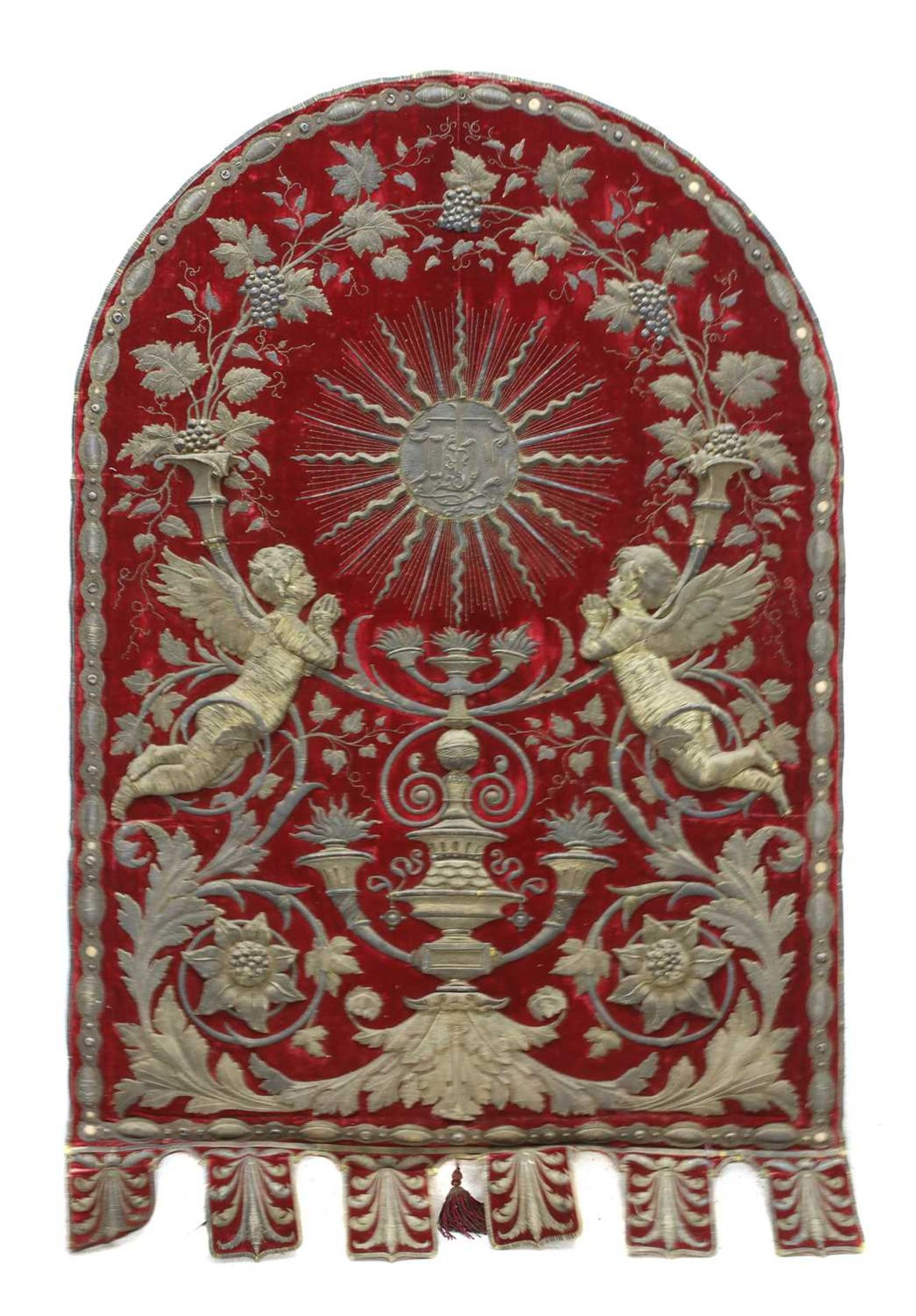 An Italian gilt and silvered metal and red velvet altar hanging,