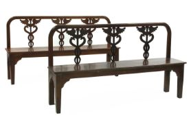 A pair of Italian neoclassical-style walnut hall seats,