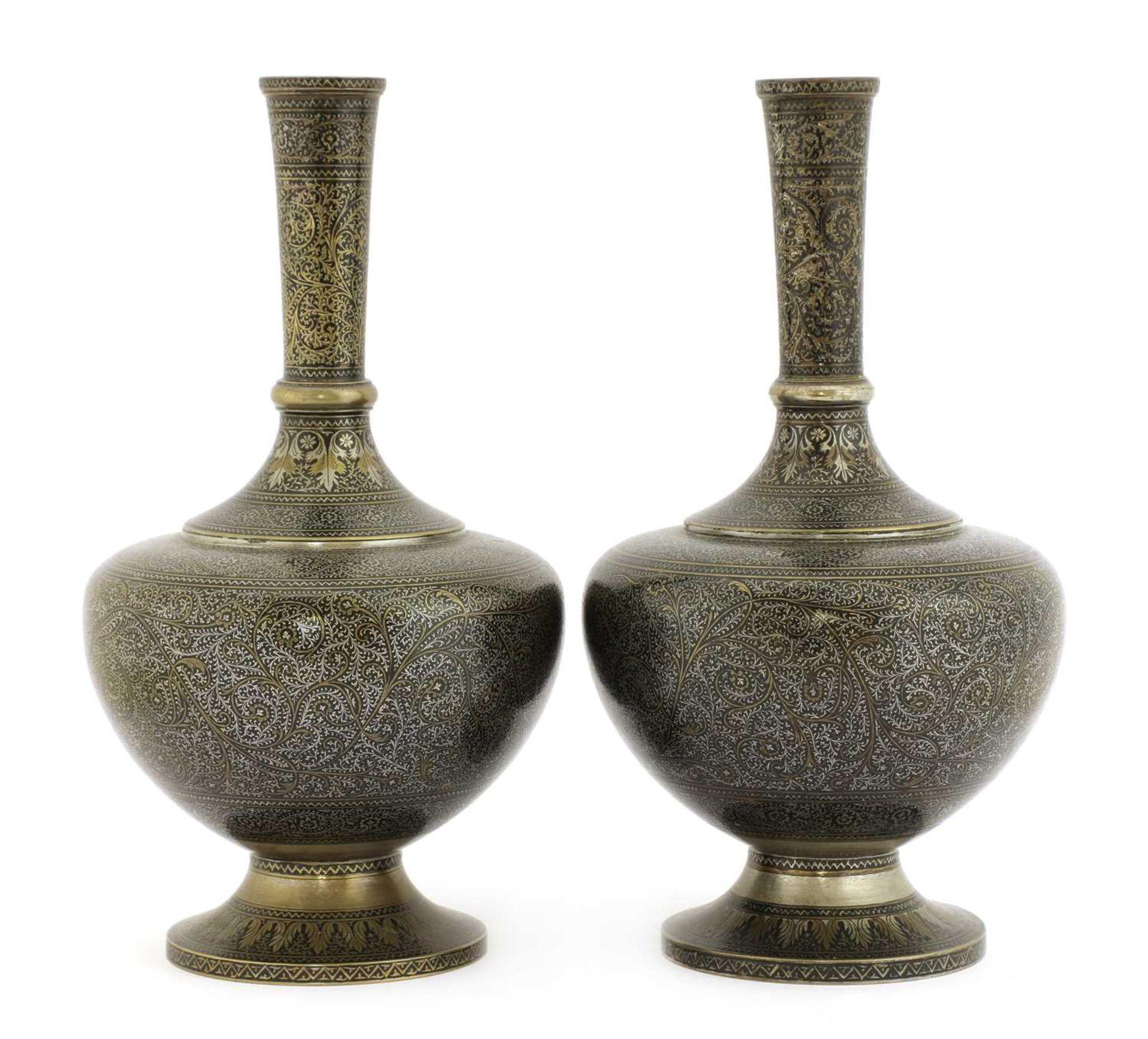 A pair of Bidriware bottle vases,