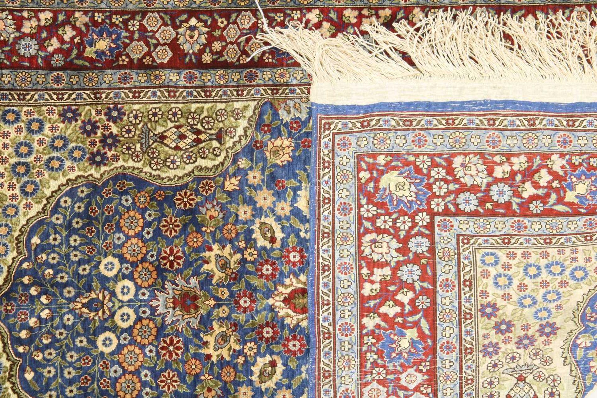 A Turkish silk and metal Hereke rug, - Image 2 of 2