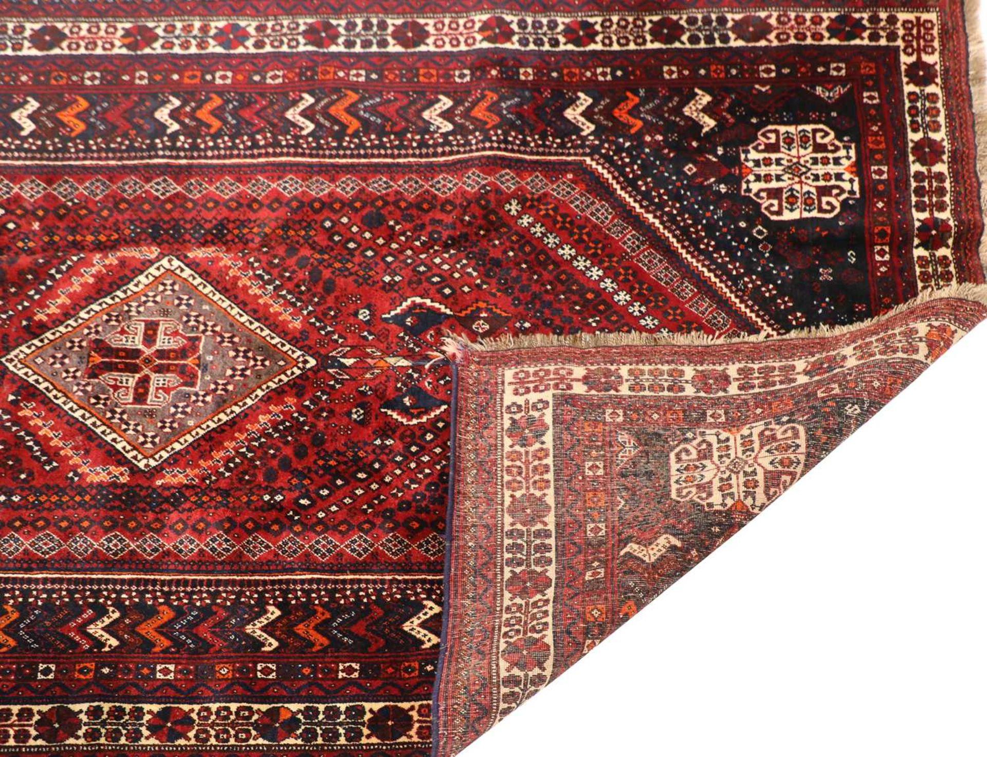 A Qashqai wool carpet, - Image 2 of 2