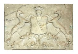 A carved marble coat of arms,