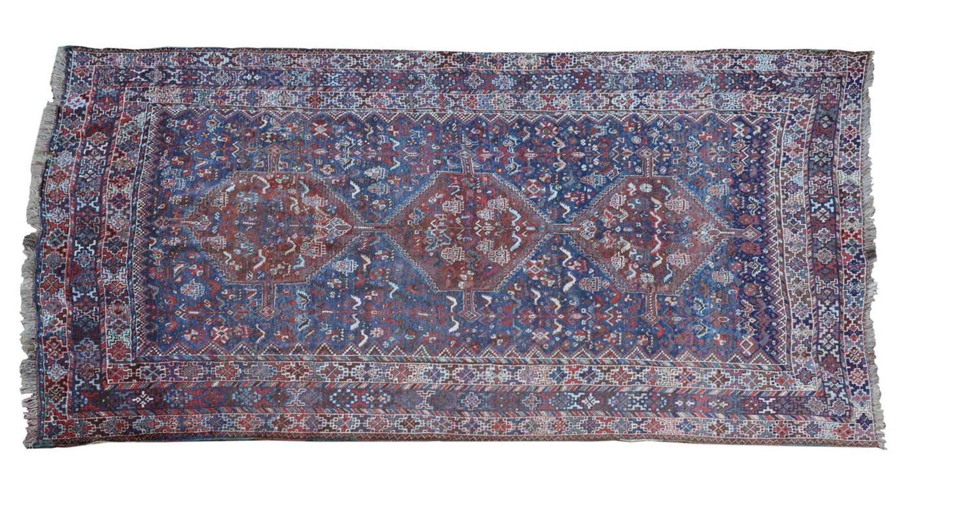 A Persian Khamseh carpet,