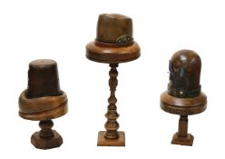 Three Continental treen hat formers,