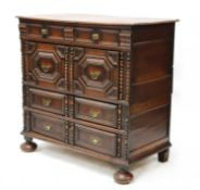 An oak chest of drawers,