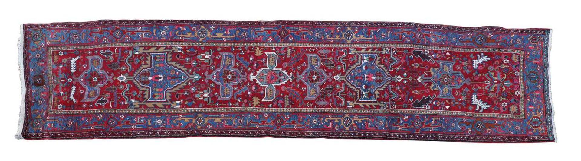 A Persian Heriz runner,