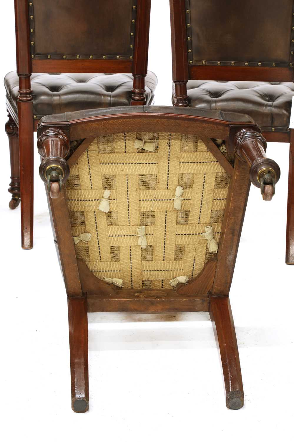 A set of six Victorian walnut and buttoned leather upholstered dining chairs, - Image 4 of 4