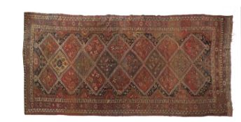 A red ground Persian carpet,