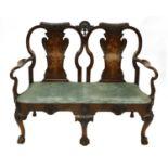 A George II-style walnut two-seater settee,