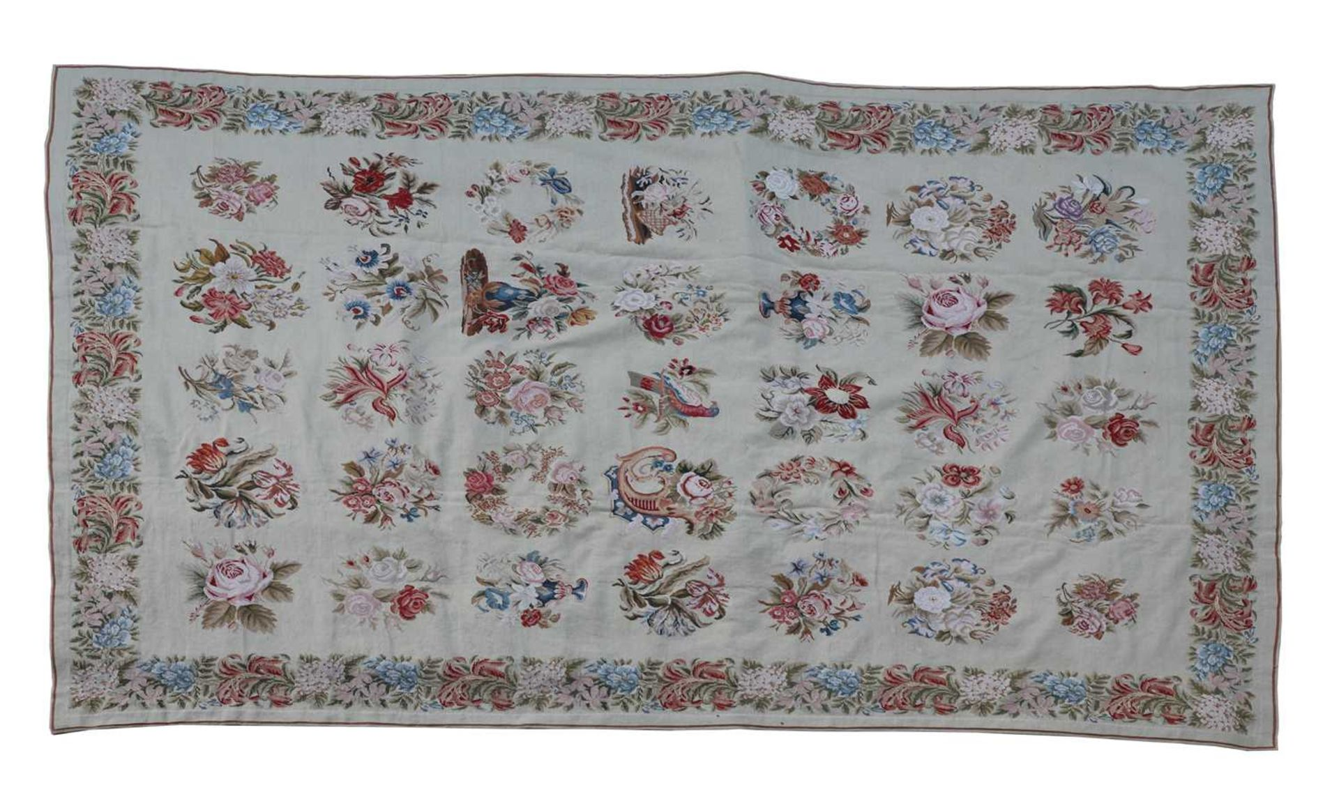 An Aubusson-style finely handwoven needlepoint carpet,