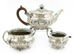 A George III silver three-piece tea service,