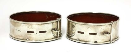 A pair of Scottish William IV silver presentation coasters in the form of dog collars,