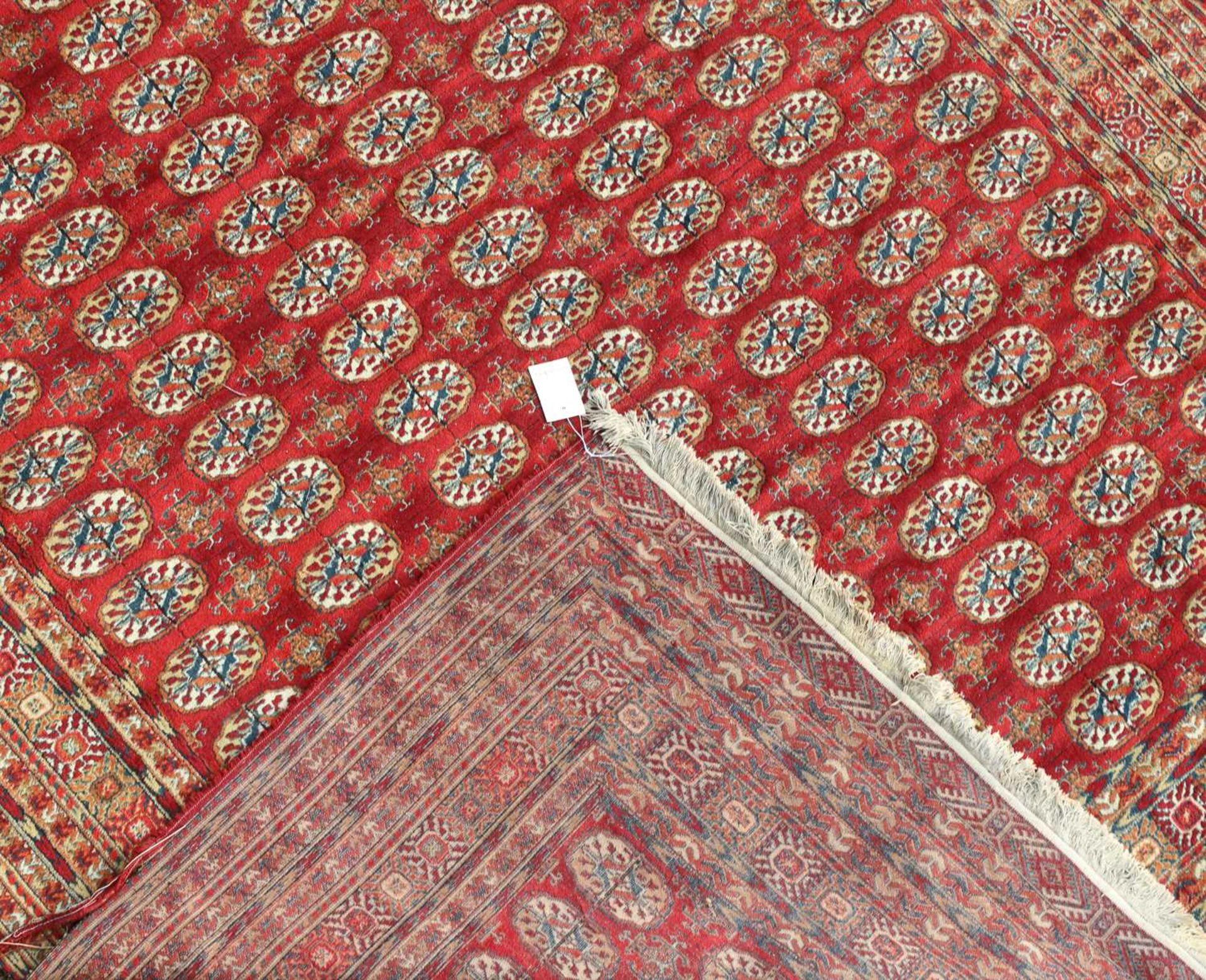 An Afghan carpet of Bokhara design, - Image 2 of 2