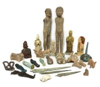 A collection of ancient and later pottery figures and artefacts,