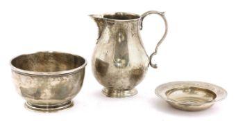A silver jug,