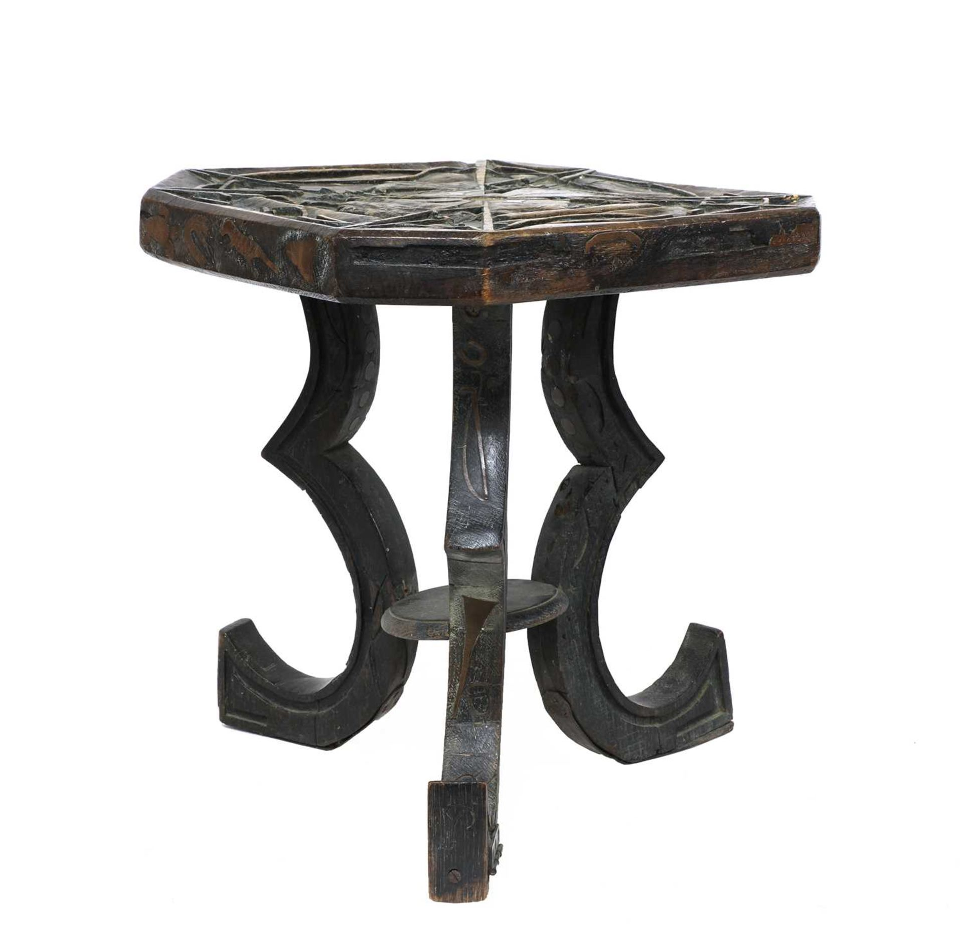 A carved and inlaid talismanic stool,