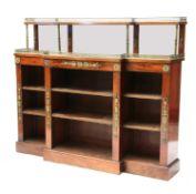 A French Empire mahogany breakfront bookcase,