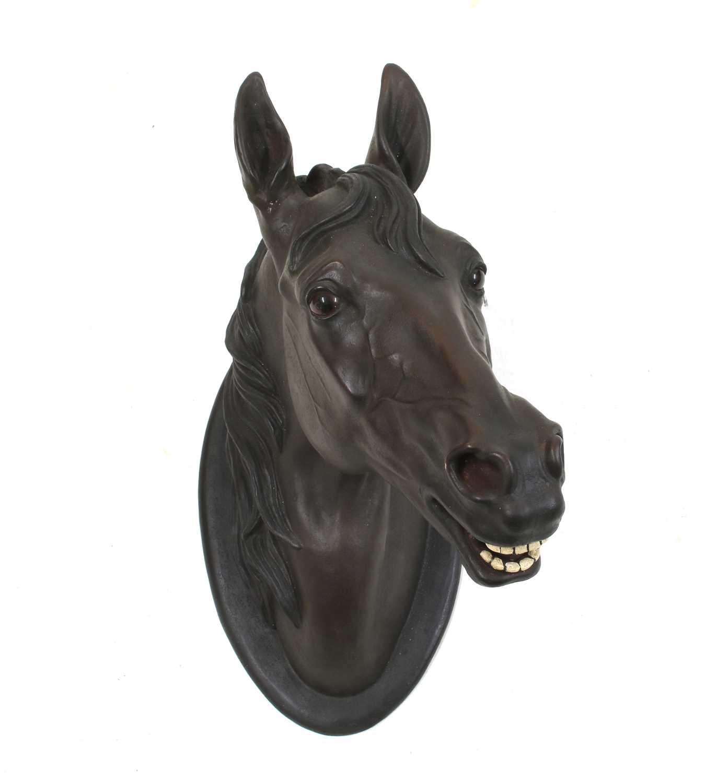 A terracotta horse's head trade sign,