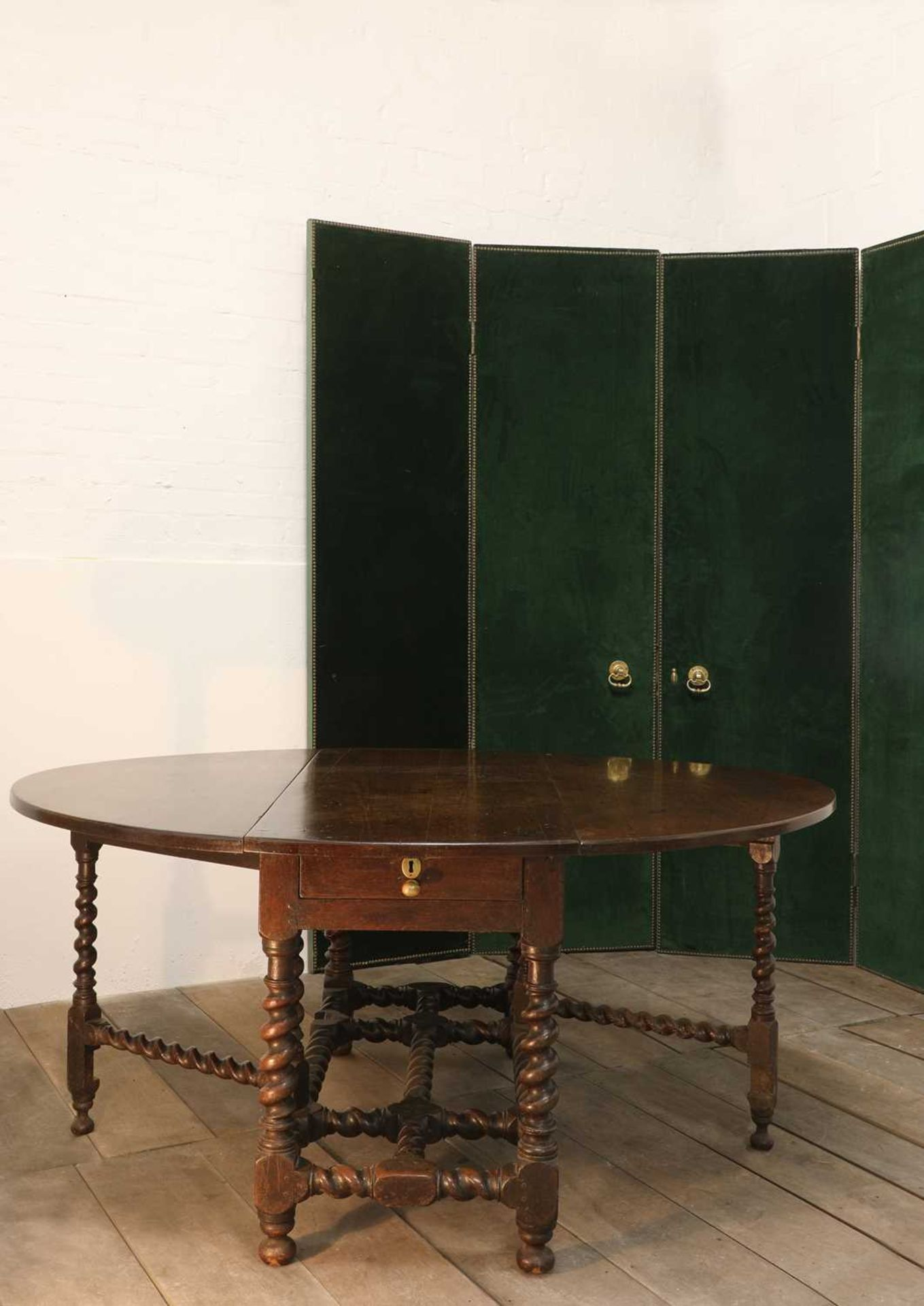A rare, large and documented, oak and mahogany gateleg dining table,